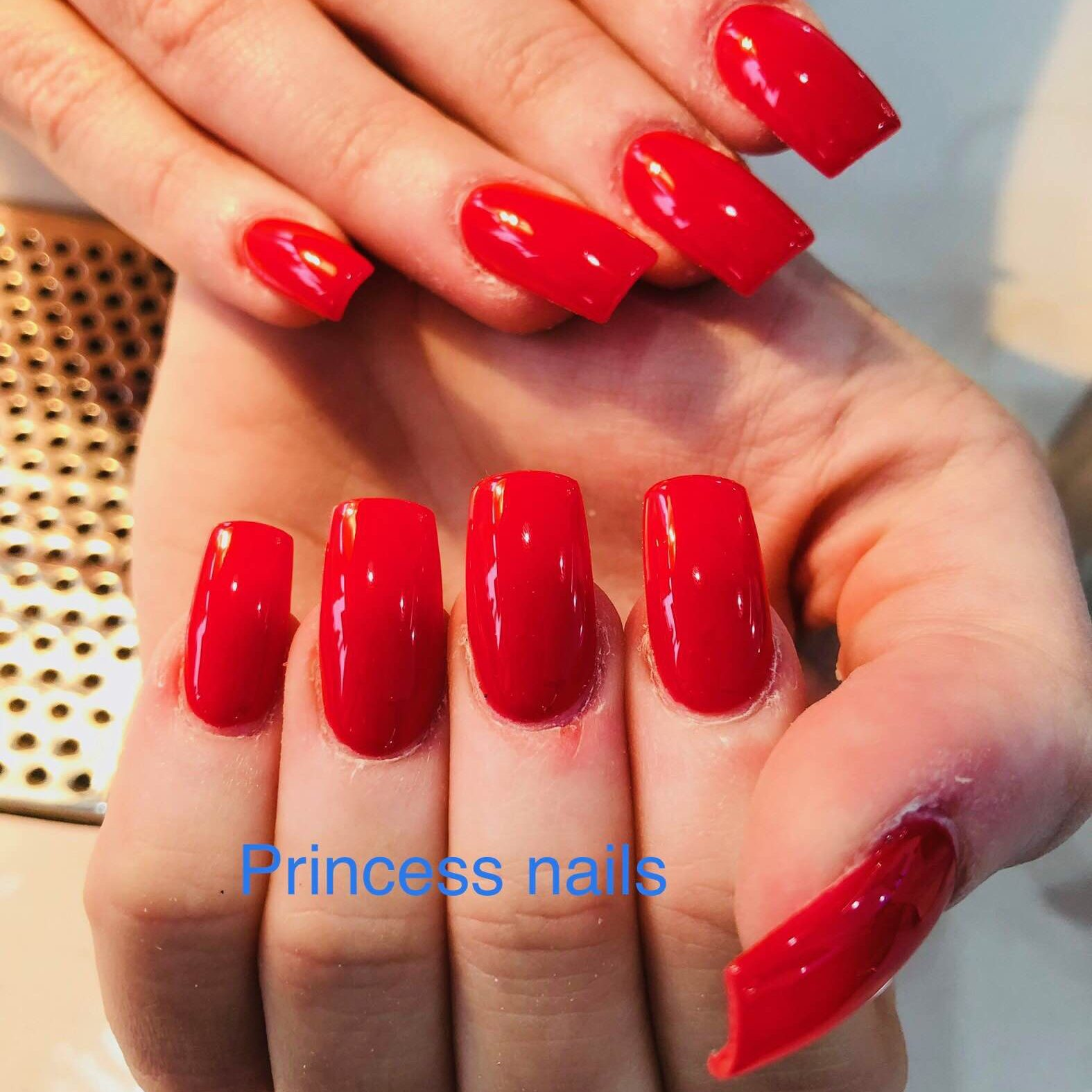 Red nail with shellac on top